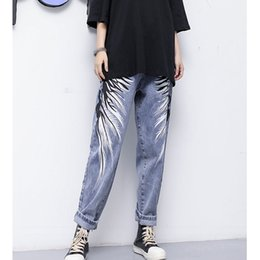 брюки с широкими ногами Скидка 2019 New Spring Summer Women Wide Leg Jeans Loose Holes Pattern Printed Denim Pants Fashion High Waist Denim Trousers