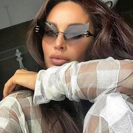 e2d8df3f2d84 wholesale Rimless Cat Eye Sunglasses Modis Oculos Feminino Angel Wings  Shades Luxury Sun Glasses Women Brand Designer 2019 winged sunglasses deals