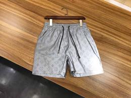 2019 tissus de vêtements de sport 2019 tissu imperméable en gros d'été hommes shorts marque vêtements maillots de bain en nylon pantalons de plage shorts de natation shorts de sport tissus de vêtements de sport pas cher