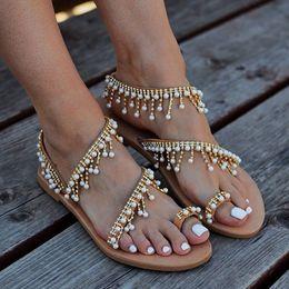 2019 Vintage Boho Sandalet Kadınlar Deri Boncuk Düz Sandalet Bayan Bohemia Plaj Sandalet Ayakkabı Artı Boyutu nereden