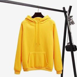 Casacos de inverno para mulheres cor amarela on-line-Outono E Inverno Amarelo Manga Longa Com Capuz Casuais Moletom Com Capuz 2018 Nova Moda Cor Pura Solto Top Camisola das Mulheres Casaco # 399430