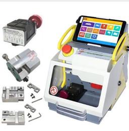 2019 x programador de herramientas 2019 Herramienta de cerrajería automática SEC-E9 Máquina de corte de llaves CNC 4 Abrazaderas Versión de idioma
