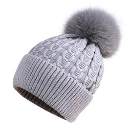 8cbcb61845bbd Female autumn and winter pattern 15cm fox fur ball hat sweet cute fashion  wild outdoor warm knit hat Bomber Hats