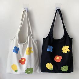 bolsos de niña de flores negro Rebajas 2019 Bolsos de compras de lona de flores para mujer Bolso de hombro de tela Bolso ecológico para niñas Bolsos plegables de uso diario Totalizador Negro Blanco