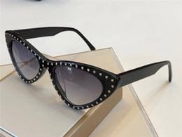 New Popular Designer Óculos De Sol 0006 Tendência Olho de Gato Quadro Óculos  de Sol Incrustada rebite Design Charme nobre estilo Eyewear Proteção UV400  ... e17a6327bb
