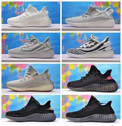 cheaper f9045 4805a scarpe adidas yeezy boost 350 v2 Adidas Yeezy Boost 350 V2 riflettente Donna  Scarpe da corsa da uomo Sneakers in bianco e nero di rame allenatore  sportive ...
