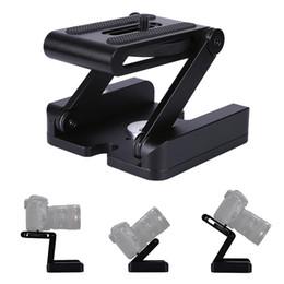 Soporte de cámara plegable online-Plegable del sostenedor del soporte Z Tipo trípode profesional Kit Flex inclinada Cabeza plegable de escritorio videocámara cámara Compatible