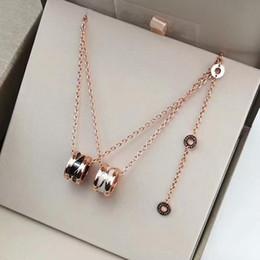 torque celtic Desconto 2019 mulheres designer de luxo jóias de cerâmica pingente de aço inoxidável da senhora de ouro rosa colar de ouro cadeias de amor colares conjunto de casamento