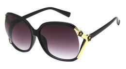 Tonalità del sole online-Occhiali da sole ovali oversize retrò donne di marca classico vintage fiore della camelia signore occhiali sfumature sunses oculos uv400 4 colori 10 pz