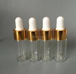 Cuentagotas de oro online-10ml / cc Botella cuentagotas de vidrio Botella transparente transparente con tapa de oro y plata Aceites esenciales vacíos para perfume