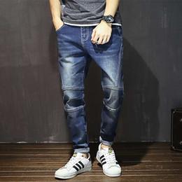 9d39eb68fcc Oversize Autumn Winter Men s Tapered Jeans Trousers Denim Harem Pant Plus  Size 40 42 44 46 48