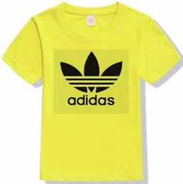 chemises à manches courtes garçon Promotion chaud nouveau t-shirt pour garçons et filles d'été 2019 nouveaux enfants à manches courtes lettres noires motif coton impression marée manches courtes