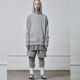 Panel inferior online-19SS FEAR OF GOD Essentials FOG Arco dobladillo Parte inferior dividida Camiseta de párrafo largo Hombres y mujeres Pareja camiseta informal HFSSTX110