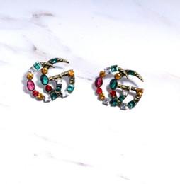 Orecchini di moda bohemien signore lettere geometriche argento ago orecchini di diamanti colore regalo accessori regalo da i supporti del telefono fornitori