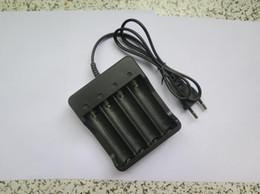 cargador de ranura Rebajas Batería de litio 18650 Cable inteligente multifunción Cargador de cuatro ranuras recargable Con cargador de batería Regulaciones Euro 4.2V
