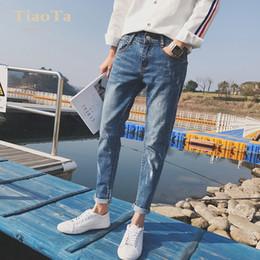 2019 jeans déchirés hommes coréens Ripped Hole jeans été été 2019 coréen pieds pieds pantalons en denim hombre Slim jeans effet jet d'encre minces jeans déchirés hommes coréens pas cher