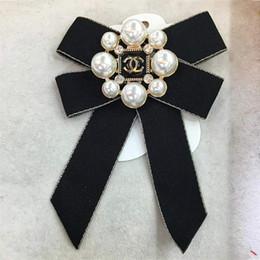 cintas arcos para las faldas Rebajas Joyería arco de la cinta broche de mujeres de la perla alfileres y broches alfiler grande para la capa de la camisa de las mujeres falda de la ropa de DHL