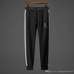 Jeans de hip hop tamaño 44 online-High Street Fashion Jeans para hombre Pantalones de chándal casuales Gran bolsillo Pantalones de carga Hombres Marca Clásico Hip Hop Army Tamaño grande ..PP6