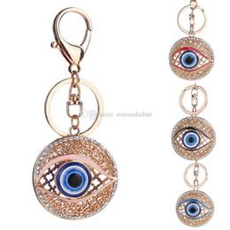 Argentina El Rhinestone del metal del ojo malvado llavero redondo azul del ojo del bolso del coche del anillo de la boda favor de regalos y el envío libre de DHL Suministro