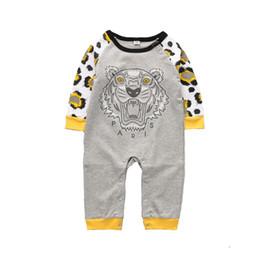 2019 esmoquin de 18 meses Ropa para niños Monos lindos Letra de cabeza de tigre Estampado de ternera y monstruo Cuello redondo simple de manga larga