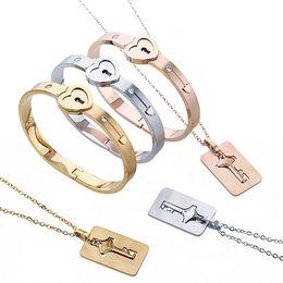 braccialetti a forma di oro Sconti Coppia di gioielli in acciaio inox con chiavi a forma di ciondolo a forma di cuore Collana con ciondoli a forma di cuore Collana con ciondoli a forma di cuore con 3 colori