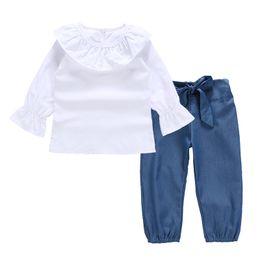 Traje de las niñas Collar de loto Camiseta de manga larga camiseta blanca + pantalón azul Traje de dos niños 2-6 años 2019 Nuevo desde fabricantes