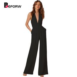 Nouvelle arrivée combinaison d'été pour les femmes 2018 mode noir profond col en v élégant blanc large jambe pantalon combinaison clubwear ? partir de fabricateur