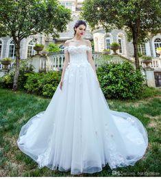 Vestidos largos chinos online-Lujo con cuentas de cristal vestido de novia vestidos de novia vestidos de novia fuera del hombro elegante de clase alta cola larga vestidos de novia hecho a mano chino