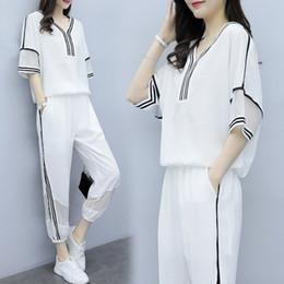 2019 conjunto de deporte de las mujeres coreanas Verano Nuevo Traje deportivo casual Versión coreana femenina Moda de adelgazamiento suelto Dos juegos de trajes de verano Tide para mujeres más tamaño conjunto de deporte de las mujeres coreanas baratos