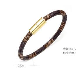 2019 arte jóias de pressão Nova moderno moda couro listrado homens e mulheres casal pulseira liga pulseira fivela magnética pulseira atacado