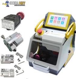 Argentina 4 Abrazadera NUEVA 2019 120 W Máquina cortadora de llaves CNC SEC-E9 Máquina cortadora duplicadora de llaves de cerrajero Herramientas igual que Miracle A9 Suministro