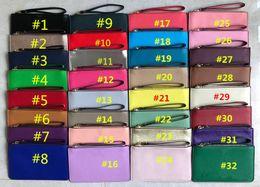 2020 bolsos de cuero bolsos para niñas Mujeres KS PU Cartera de cuero Wristlet Cremallera Monedero Bolso Bolsa de viaje Deportes al aire libre Tarjeta de crédito Bolsas de dinero Bolso de las niñas Monedero 32 colores bolsos de cuero bolsos para niñas baratos
