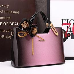 Argentina Bolso de cuero de las mujeres de alta calidad bolso de noche floral 2018 nuevo caramelo negro rojo púrpura charol diseñador de cuero bolso monedero Tote cheap red patent evening bag Suministro