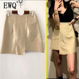 e1f0d68f5c 2019 nuevas tendencias moda falda  EWQ  2019 primavera nuevo estilo coreano  Pu cuero brillante