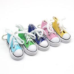 Niños zapatos de lona de dibujos animados online-Zapatos de lona clave Anillo llavero del bolso de la mujer del encanto hombres hijos Deportes titular de la clave de regalo blanco zapatilla de deporte llavero colgante KKA7527 regalo