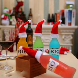 Cena de navidad decoraciones de fiesta online-Hot New Christmas Wine Bottle Caps Decoración de mesa de cena del partido de Santa Hat Hat para el hogar Decoración de Navidad