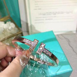 Große armband armbänder gold online-Hochwertiger Markennamenarmreif mit großen Diamanten für Frauenarmbandart und weisehochzeitsschmucksachegeschenk PS6283A