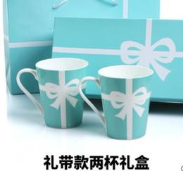 2019 regalos en forma de camara Cerámica Oficina de Hogares marca de la taza de China de hueso taza de café de la taza fijadas Europea La pareja Regalos Y19070103