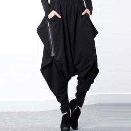 Pantalones de harén para mujer Pantalones largos de hip-hop con corte de caída y talla grande Pantalones de talla grande desde fabricantes