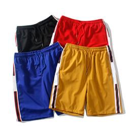 Diseñador para hombre Pantalones cortos de verano Pantalones Moda 4 colores letra impresa pantalones cortos con cordón 2019 relajado Homme lujo pantalones de chándal desde fabricantes