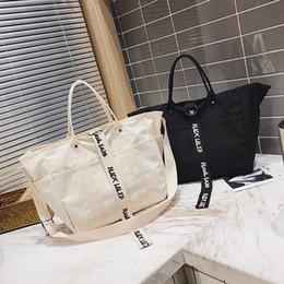 weiße farbe handtaschen Rabatt 2020 Designer-Leinwand-Handtaschen Frauen Männer Einkaufstasche Wiederverwendbare Einkaufstasche Farbe Schwarz Weiß Taschen