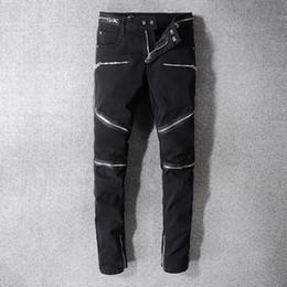 Jeans estilo rock para hombre online-Rock Star Balmain hombres angustiados rasgada del diseñador de moda de los pantalones rectos de la motocicleta del motorista Jeans Denim causal Streetwear estilo de la pista