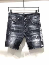 Moda de jeans rotos online-Diseño de moda italiana D2 hombres rip rasgados pantalones cortos de mezclilla monogrammed negro pantalones vaqueros de la motocicleta pantalones calientes estilo personalidad pantalones vaqueros viejos tro