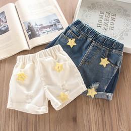 fa1675c1cbc3d8 jeans stelle fori Sconti Estate 2019 nuove ragazze pantaloncini stella buco  bambini Jean bicchierini denim bambini