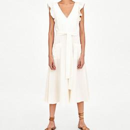 ropa blanca playa moda mujer Rebajas 2019 mujeres ocasionales vestido de verano de lino blanco Fajas sin mangas Backless Bow Vestido de playa Moda volantes bolsillo Midi vestido