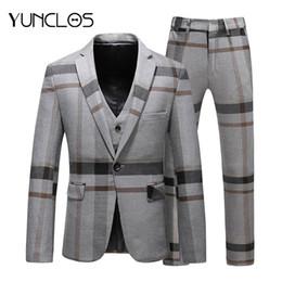 2019 traje clásico color azul marino YUNCLOS Classic Plaid Trajes para  hombre Trajes de 3 piezas ad102026f06