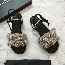 2019 chicas zapatos de boda marfil 2019 Marca Perlas Diseñador de goma de deslizamiento sandalias planas de verano Flip flop zapatillas de playa causales zapatos