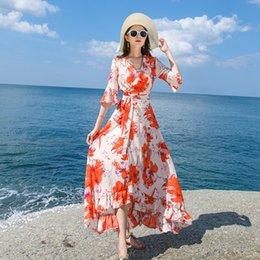 vestido novo vestido vermelho Desconto As mulheres se vestem bege floral vermelho imprimir plissado boho sol sexy arejado longa praia uma linha de envoltório de alta qualidade moda nova aparência senhora vestidos