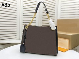 2021 dames concepteur porte-documents 2021 Nouvelle designer femelle Empreinte Cuir Chaîne d'or Sac à bandoulière Dames Diagonal Sac de Cowhide Sac d'embrayage de Cowhide Sacoche Porte-documents Porte-monnaie promotion dames concepteur porte-documents