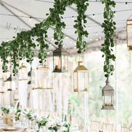 Hojas de eucalipto artificial online-Dense Leaf Artificial Eucalyptus Garland Faux Silk Eucalyptus Leaves Vine Garland Greenery Wedding Backdrop Arch Wall Decoration EEC2873